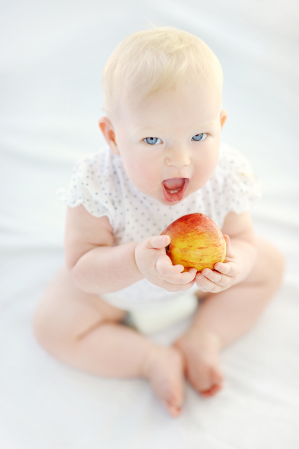 Baby eating a healthy apple